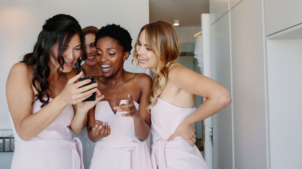 Bride and bridesmaids checking out social media feeds